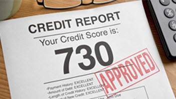 Photo of a credit score report with approved stamped on the front