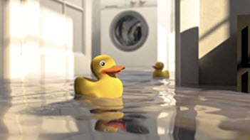 Rubber duck floating on water in a laundry room