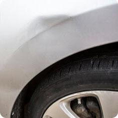 Example of paintless dent repair, before