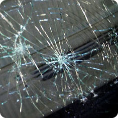 Image showing bullseye damage to a windshield.