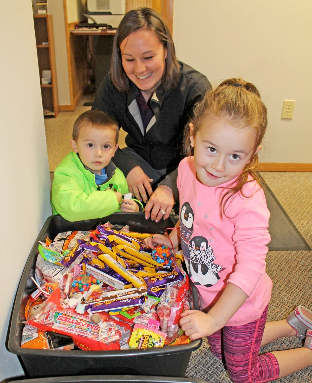 Candy Buy Back: Kids and mom showing their candy.