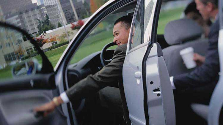 Person getting into his car after deciding what his car insurance premiums will be.