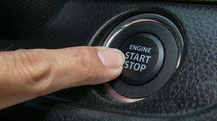 Finger pressing engine start/stop button