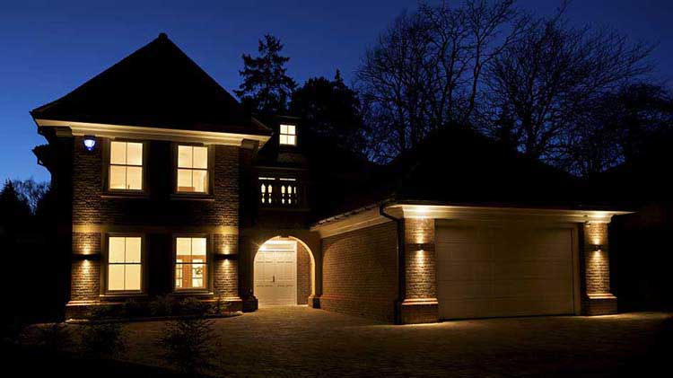 A house at night with interior and exterior lights on