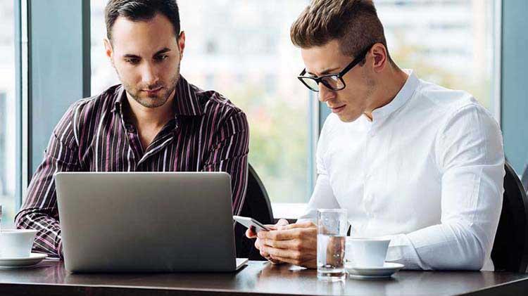 Two men at a laptop