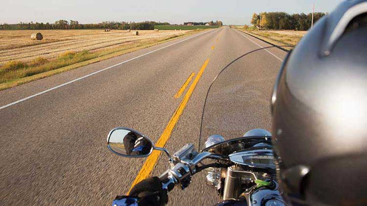 Motorcycle rider's-eye view of the road