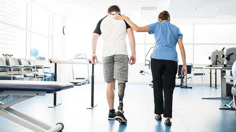 Man who has lost a leg getting assistance walking