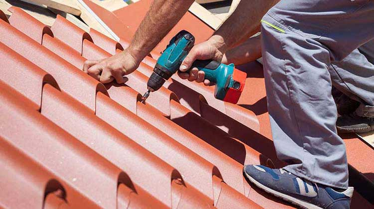 Man installing a metal roof