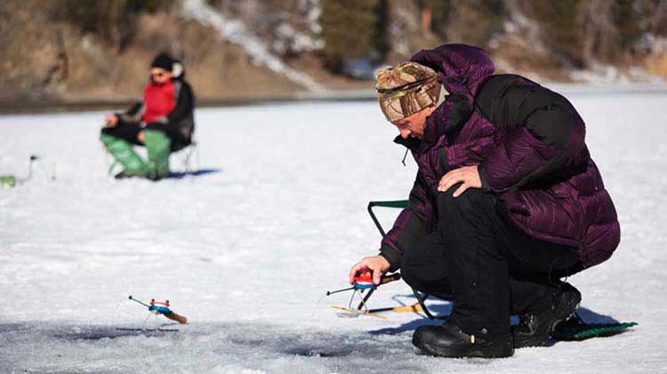 Two people ice fishing
