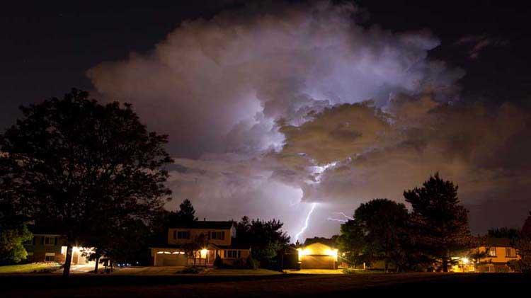 Lightning striking in a residential neighborhood