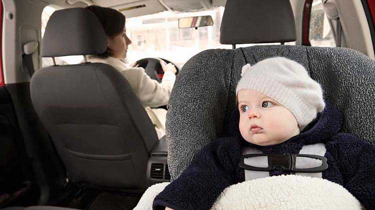 Baby in a car seat in the passenger row