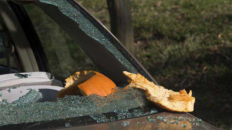 Car windshield shattered by pumpkin