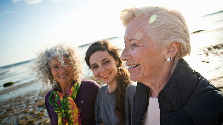 Three women discussing annuities and life insurance
