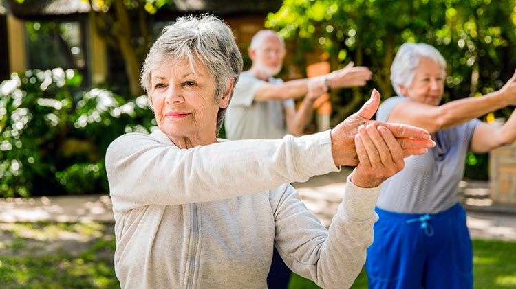 Woman exercising in a retirement community.