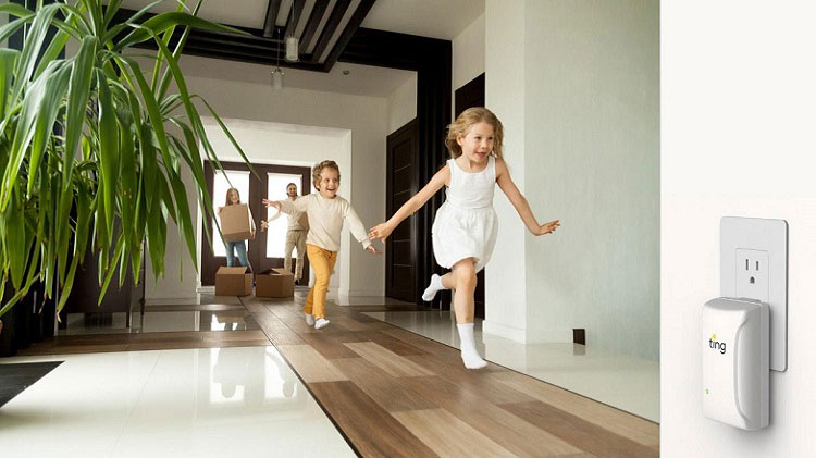 Kids are running down the hallway in their house.