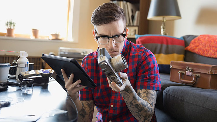 A man is reviewing the appraisal of an antique camera.