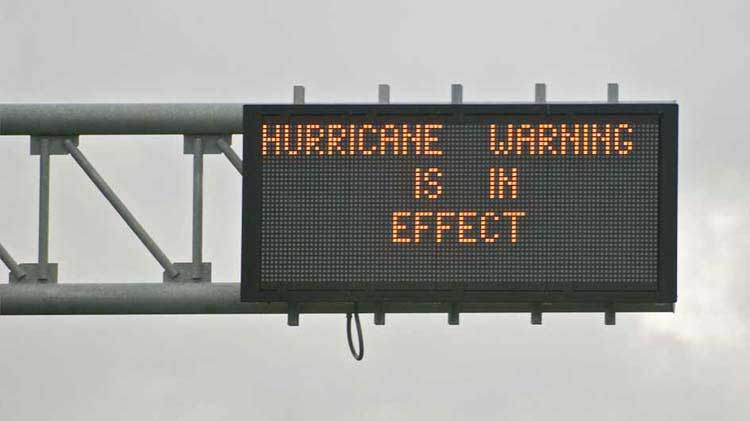 Sign announcing a hurricane warning, reminding people to prepare their hurricane evacuation plan.