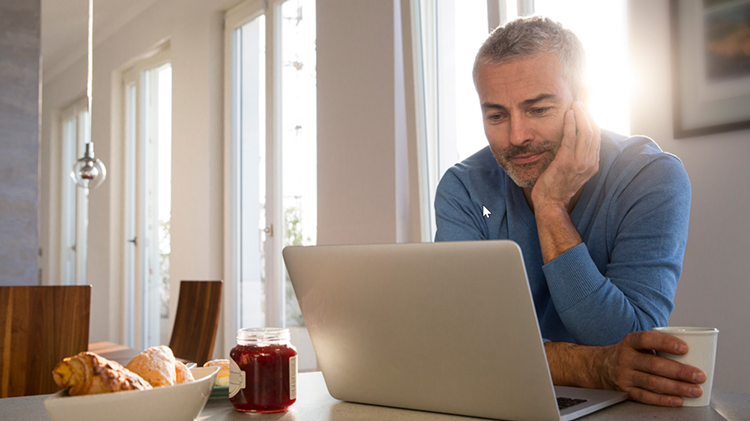 Man reviewing finances on his laptop