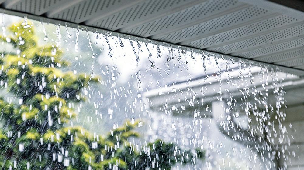 Rain running off impact-resistant roof