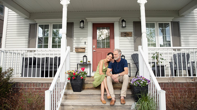 Couple on steps discussing paying off mortgage