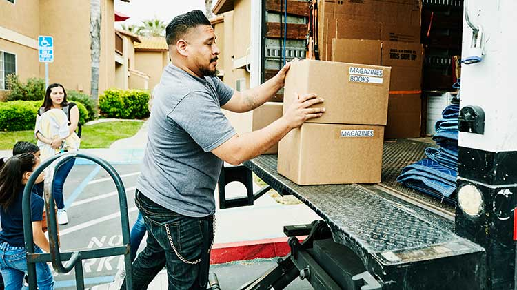Man packing moving truck to relocate for a job.