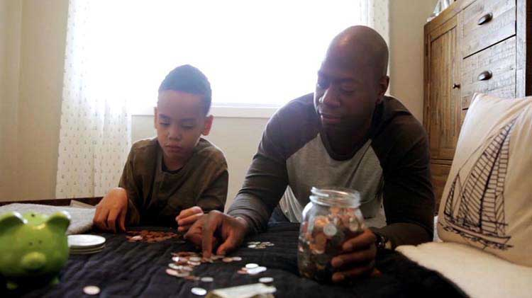 Father and son counting coins