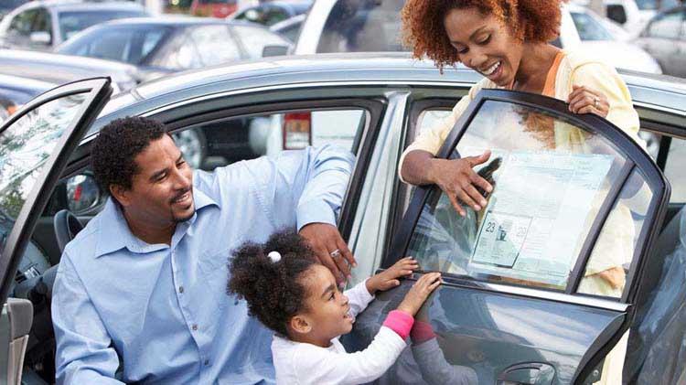 Family looking at new car