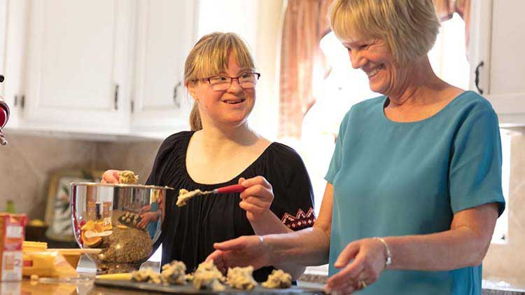 Two women baking cookies