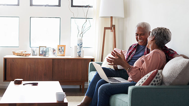 Couple making plans for spending and saving in retirement